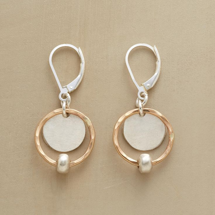 """SILVER SATELLITE EARRINGS -- In these silver and gold satellite earrings, hammered 14kt goldfilled rings punctuated with matte sterling silver beads encircle textured sterling silver disks. Sterling silver leverback wires. USA. Exclusive. 3/4""""L."""