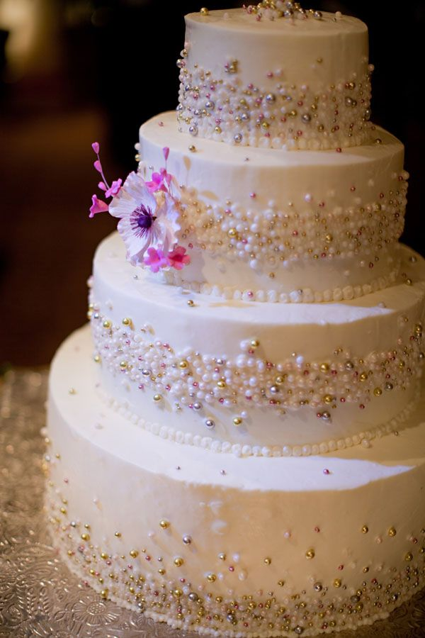 this cake is striking. the beads are so elegant  but with a touch of glam :)