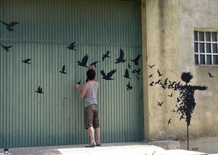 Spanish Artist Pejac Spreads Poetic Street Art Around European Citites - Bird Spreader in Salamanca