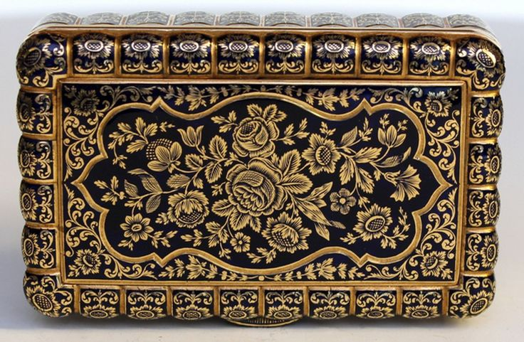 Swiss Gold and enamel Snuff Box By Bautte and Moynier Geneva Rectangular with scalloped edge  the cover and base with Dark Blue  champlevé enamel floral arabesque panel  surrounded by floral and acanthus decorated flutes extended down the side  length 8cm  wt  160 gms.