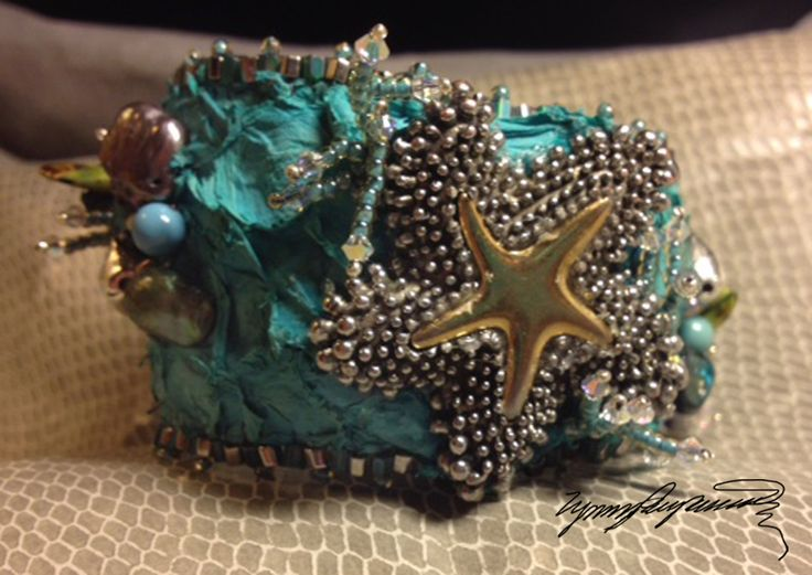 https://www.etsy.com/shop/LynnParpard?ref=pr_shop_more One of a Kind Art piece made one bead at a time Starfish could be yours !