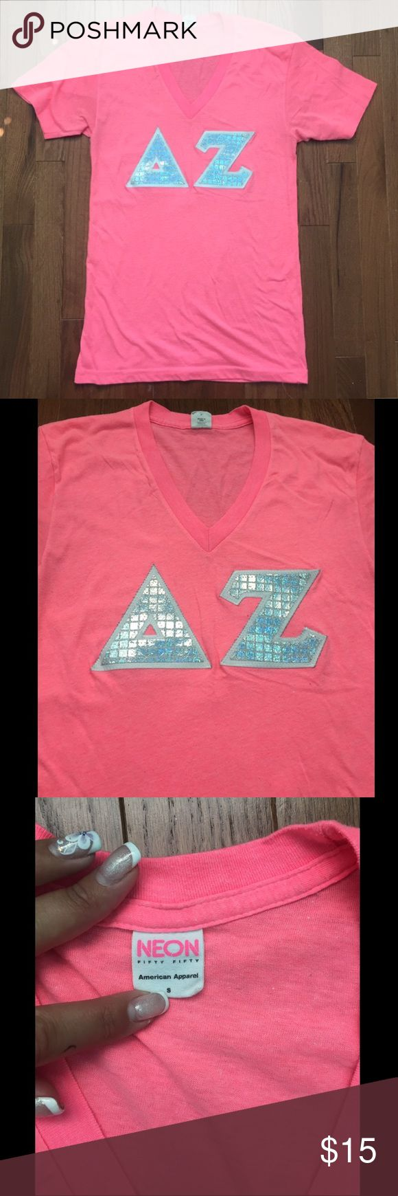 Delta Zeta American Apparel V-Neck 😍 Super cute silver Delta Zeta letters on a neon pink American Apparel V-Neck in a size small! Gently worn but some piling in the fabric from wear but still a great item 😍 American Apparel Tops Tees - Short Sleeve