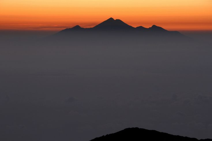 Mt Rinjani in the distance, from the summit of Mount Agung in Bali, Indonesia