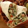 This kid-friendly recipe for a super school lunch is a twist on the traditional BLT. Call it a rollup or a wrap but use it for the kids' lunch boxes or your own brown-bagging. It's a chopped salad filling with the flavors of a BLT in a tortilla wrap.