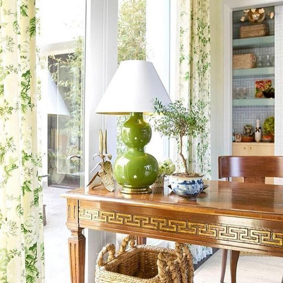 Amy Berry Design - Traditional Home A Greek key writing desk is styled with a double gourd Chinese lamp and a blue and white Chinese pl...
