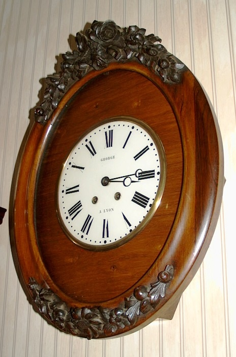 Bulls eye clock 1855 in mahogany