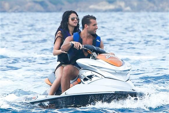 Selena Gomez joins a pal for a ride on a jet ski in St. Tropez on July 22, 2014.