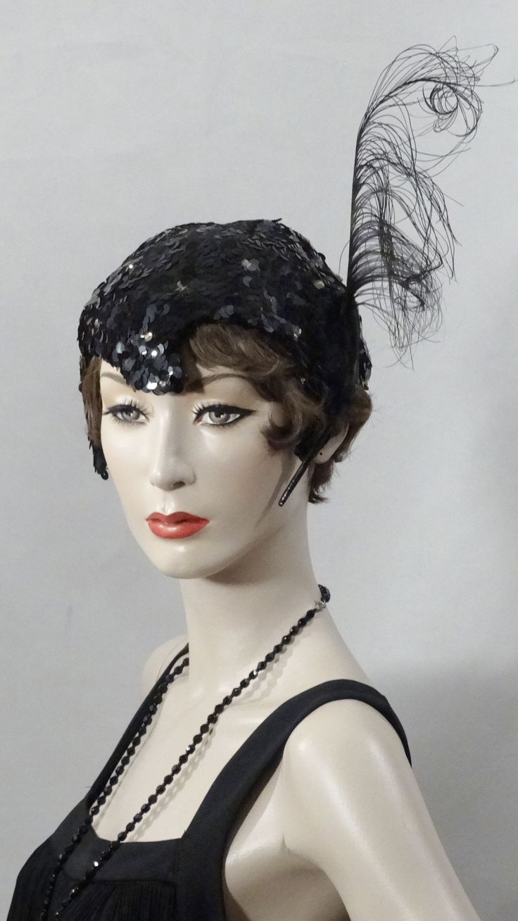 1920s-1930s black sequin burlesque helmet with tall bird of paradise feather