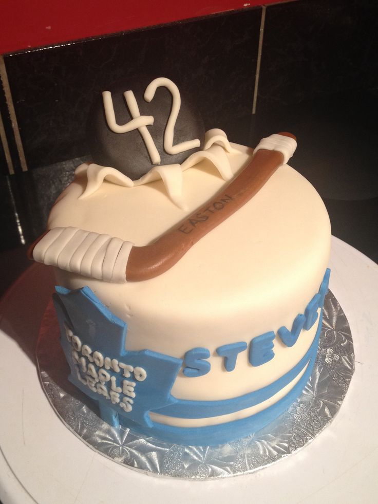 Toronto maple leafs cake  Golden cake covered in buttercream in ing and fondant
