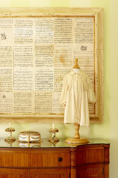 Old sheet music into art. I have soooo much old sheet music- why did I never think to paste it all together in a massive hanging?!