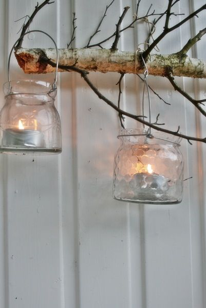 stick or branch from your own yard to hang candles, pictures, anything