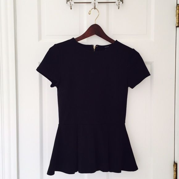 Black peplum top This black peplum top from Forever 21 is a classic silhouette you need in your wardrobe. Pair with skinny ankle paints or a pencil skirt to quickly look polished and put together. The gold zipper detail on the back makes this piece modern and fun. Forever 21 Tops