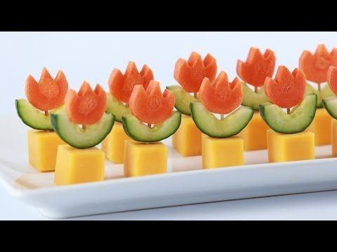 SUPER MARIO FIRE FLOWER APPETIZERS - NERDY NUMMIES  square cookie butter for cutout on cucumbers, tear drop cookie cuter to slice off flower out of circle.
