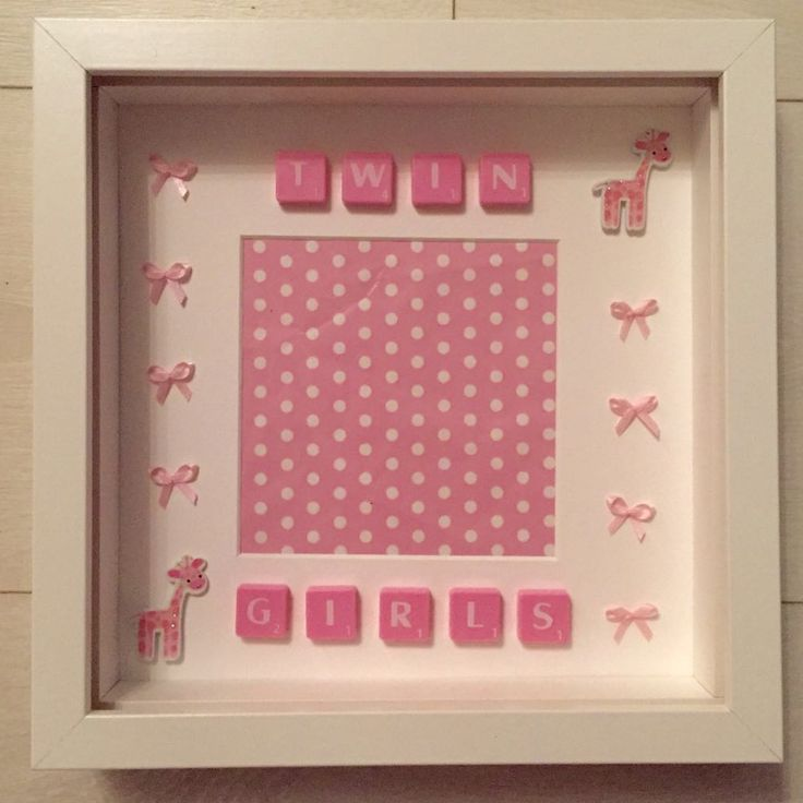 "White Frame - 23 x 23cm (9 x 9"" approx) Tiled message: TWIN GIRLS Detailed with pink tiles, pink giraffes and pink bows.  Personalised picture frame custom made to your requirements.  Available in Black or White frames.  Lettered tiles available in Black, White, Blue or Pink.  Tiles available in a Large or Small font.  Design is bespoke to your request, including buttons, starts, hearts, beads, bows, and a whole lot more embellishments."