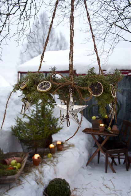 Used grapevine wreaths from thrift store covered in pine branches, dried fuit slices and hung with jute rope.
