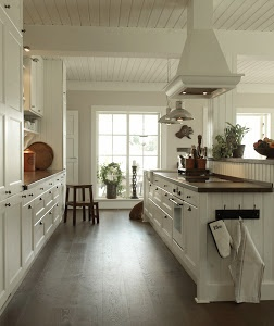 Love the white with the darker colored wide-planked floors.  The only problem with darker floors is that they show EVERYTHING.