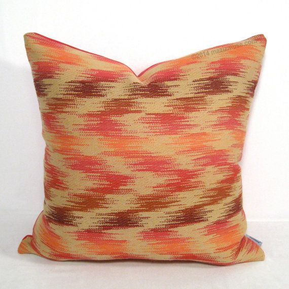 modern pink orange and wine ikat pillow for indoor and outdoor spaces from