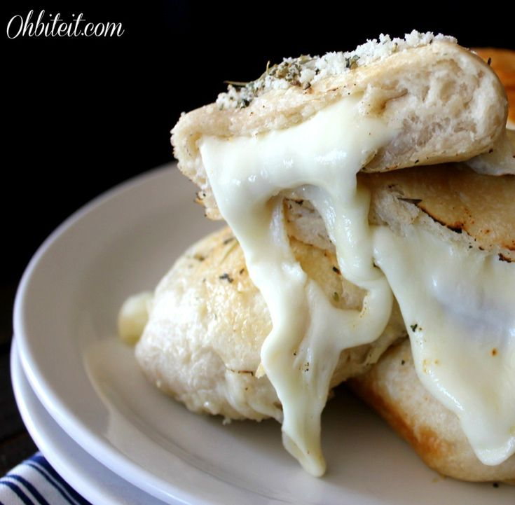 ~Cheesy Biscuit Bombs! | Oh Bite It,   Use smaller biscuits, some other cheese besides mozzarella and vgourmet.com Herbs de Provence inside, with parmesan on top.