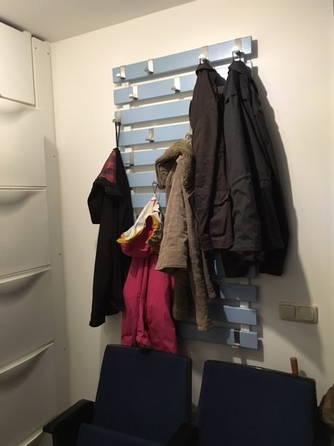 A DIY Coat Rack from the IKEA SULTAN Lade bed slats and some Z shaped hooks. Its great and hangs a ton.