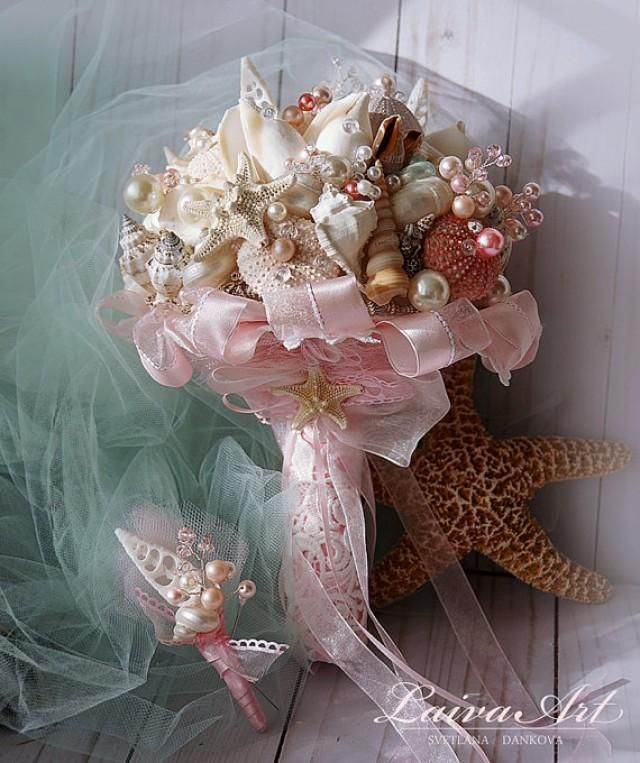 Beach Shell Bouquet Starfish Bouquet Blush Pink Beach Wedding Bouquet Seashell Wedding Bouquet with Boutonniere A variety of silk, shells, pearls, Swarovski crystal beads add an elegant natural look. Beautiful satin ribbons and lace wrap the handle and ribbons flow from the tulle. When your beautiful wedding is over, this incredible piece becomes a family treasure.