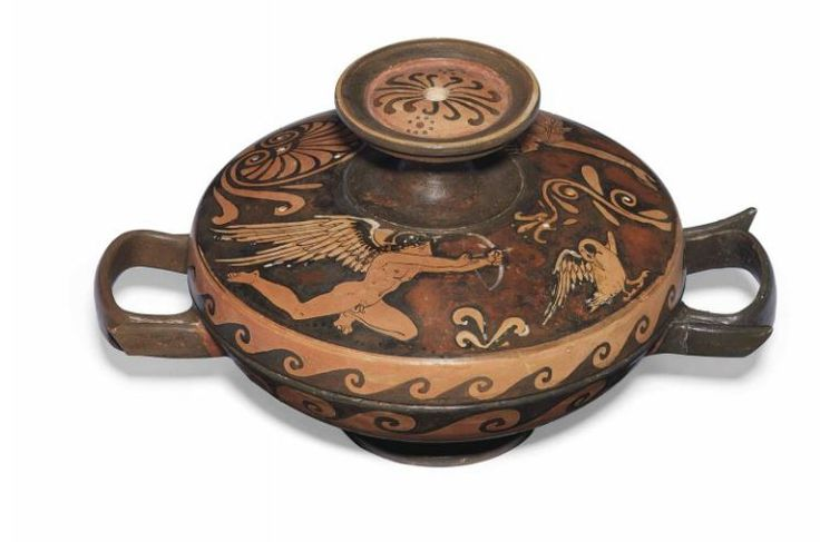 Sicilian red-figured lekanis, attribuited to the Lentini Manfria Group, 310-300 B.C. The lid with a seated draped female, leaning back on her outstretched right arm, wearing a peplos with dotted borders, earrings, a necklace and bracelets, a radiate stephane in her bound hair, looking back at the nude winged figure of Eros aiming his bow and arrow at a swan,  the knob with double palmette and two dotted rosettes, details in added white, 20 cm wide with handles. Private collection