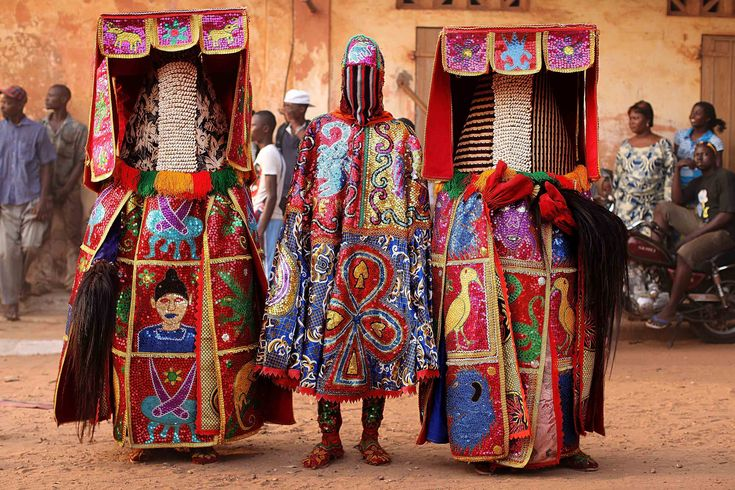 Picture of two people in traditional Egungun costumes, Nigeria