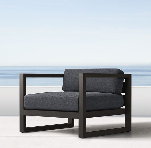 RH's Aegean Lounge Chair:Influenced by the low, linear silhouettes of seaside architecture, our contemporary collection is designed by a family-owned company in Australia known for its meticulous metalwork. Its superior materials and simple geometry enable it to weather the elements in enduring style.