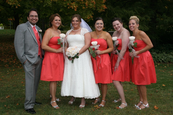"""Guava Bridesmaids, coral vest and tie for my brides""""man""""   Wedding gown and girl's dresses from David's Bridal.  Tux from Savvi Formalwear Springfield, Illinois.  Girls carried a single flower."""