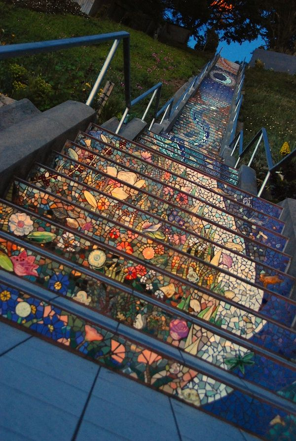 "The 16th Avenue Tiled Steps. Irish ceramist Aileen Barr and mosaic artist Colette Crutcher joined forces, working with over 300 community volunteers. ""The steps paint a picture of the sea flowing into the sky. A colorful twist of water and sea life swirl up the steps to land with flowers, plants, birds, and frogs and ends with a beautiful sky with stars and even a massive sun."" - Alice S."