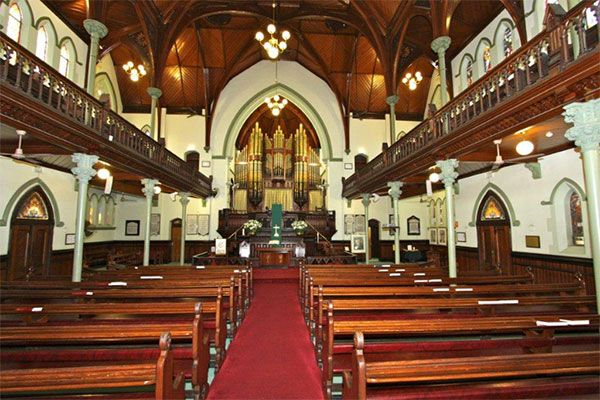 The interior of our church features beautiful woodwork.