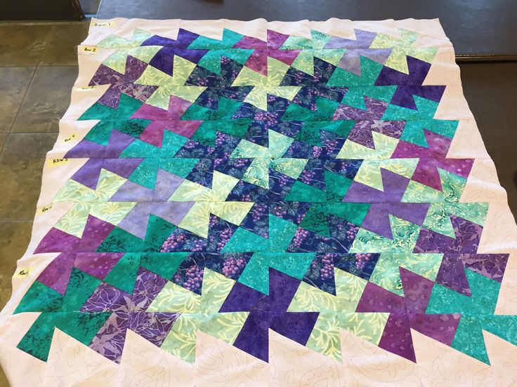 "Twister quilt made from using 6 1/2"" squares and the midi twister ruler.  Started with purple grape fabric as a challenge project.  Now to add a border, appliqué and quilt it.  By Dawn"