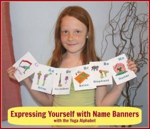 a girl holding a banner made of letters of her name from the kids yoga alpahbet