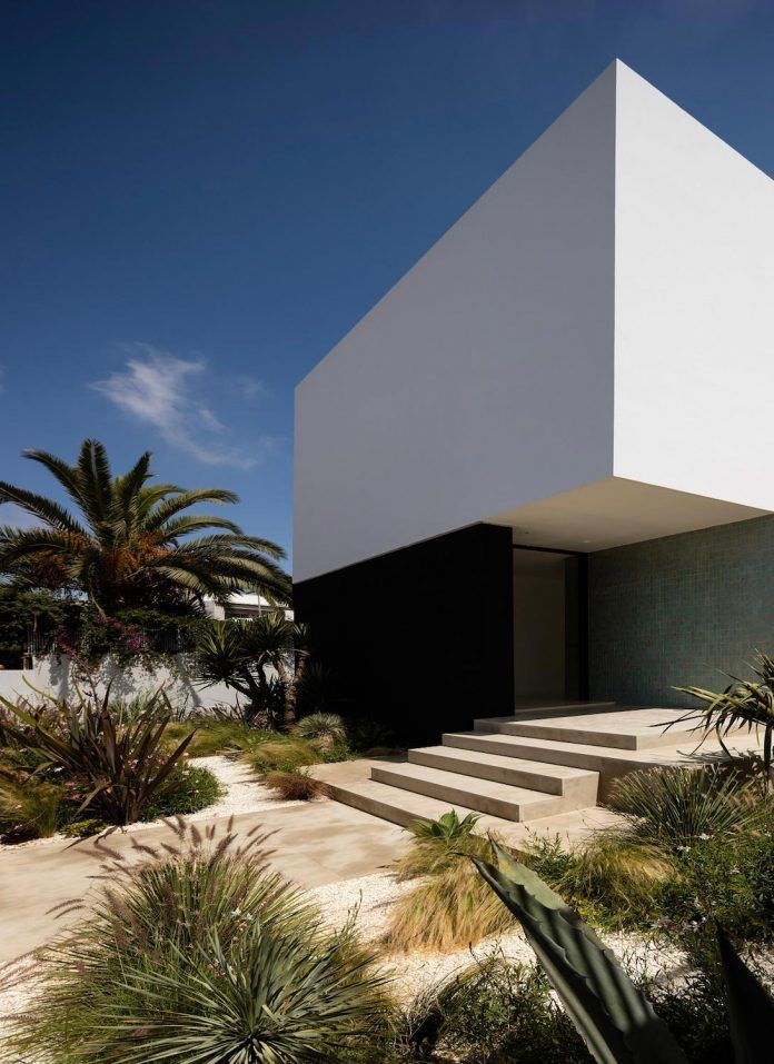 Blind façade on the street while being largely open on the side and the back - CAANdesign | Architecture and home design blog