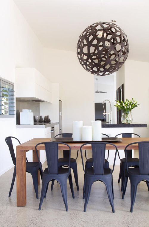 Matte Black Tolix Chairs Surround A Rustic Contemporary Wood Table For Chic