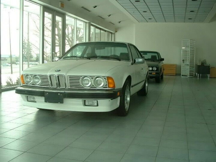 Abandoned BMW dealership in Canada, left since 1988, it contains a BMW 6 series, 5 series and a number of cars in the garage area.