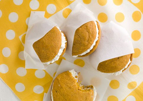 pumpkin whoopie pies with maple-marshmallow cream filling.   i will be making these for my co-workers and eating vicariously through them.