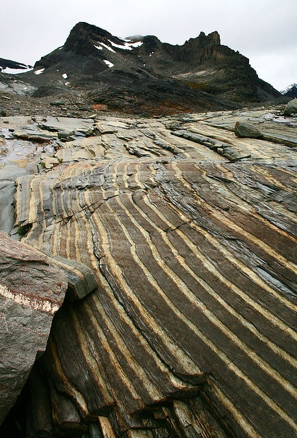 Striped rock layers at the head of Vermont Creek. Mt Syphax behind;  Columbia-Shuswap, British Columbia, Canada