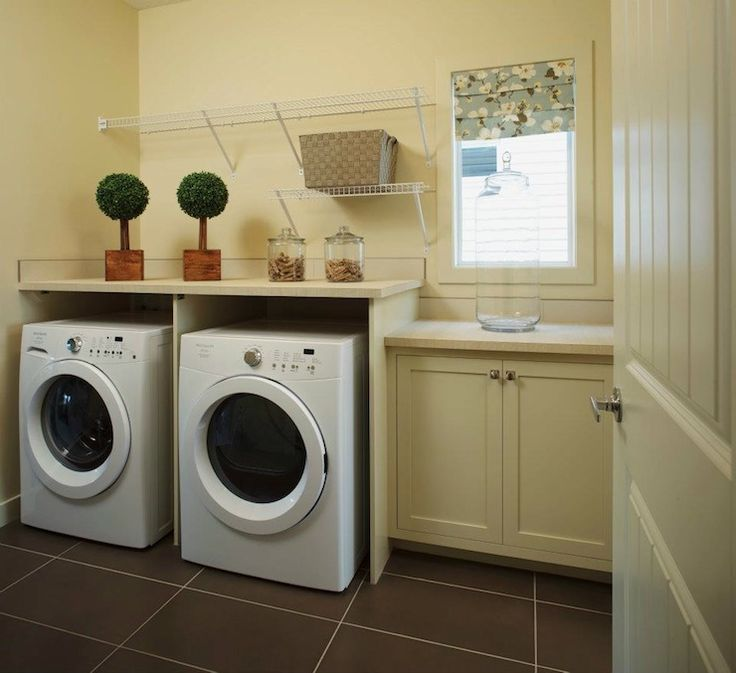 White front-load washer and dryer hidden behind black doors. Description from decorpad.com. I searched for this on bing.com/images