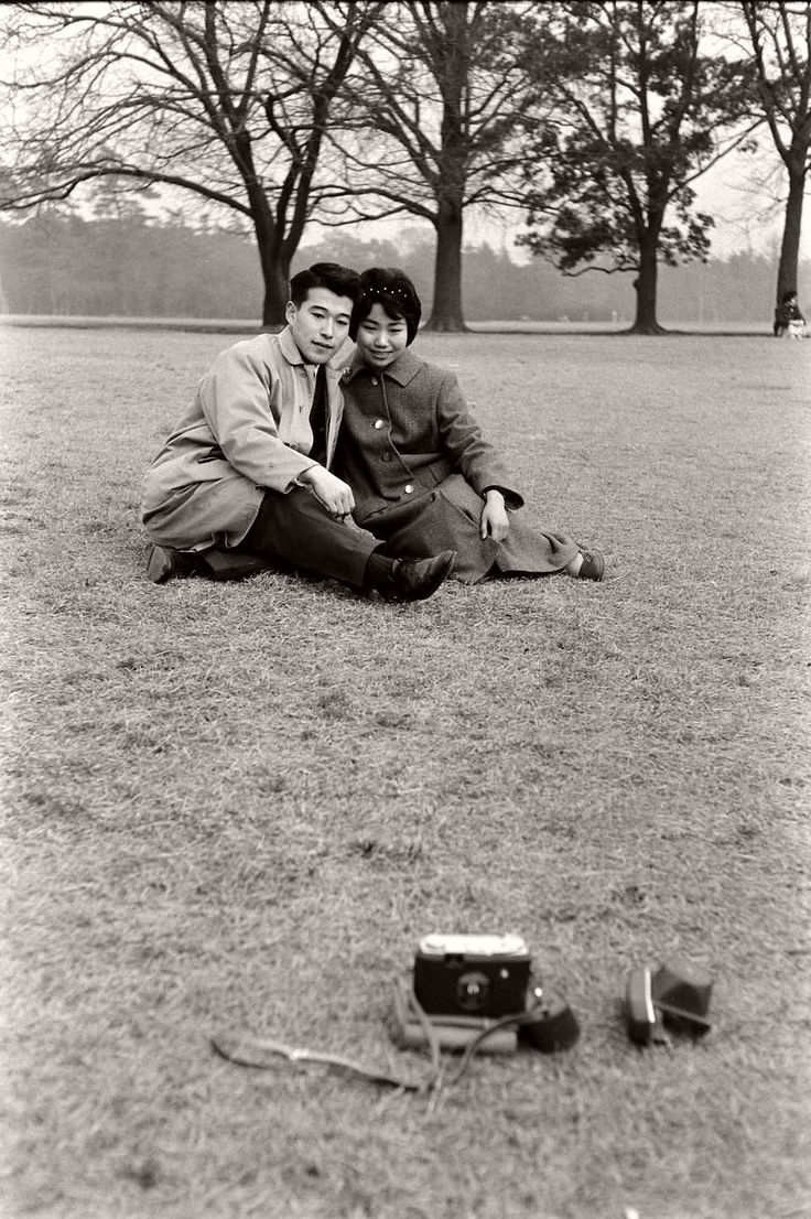 """A young couple takes a """"selfie"""" on a self-timer on their camera.  1959"""