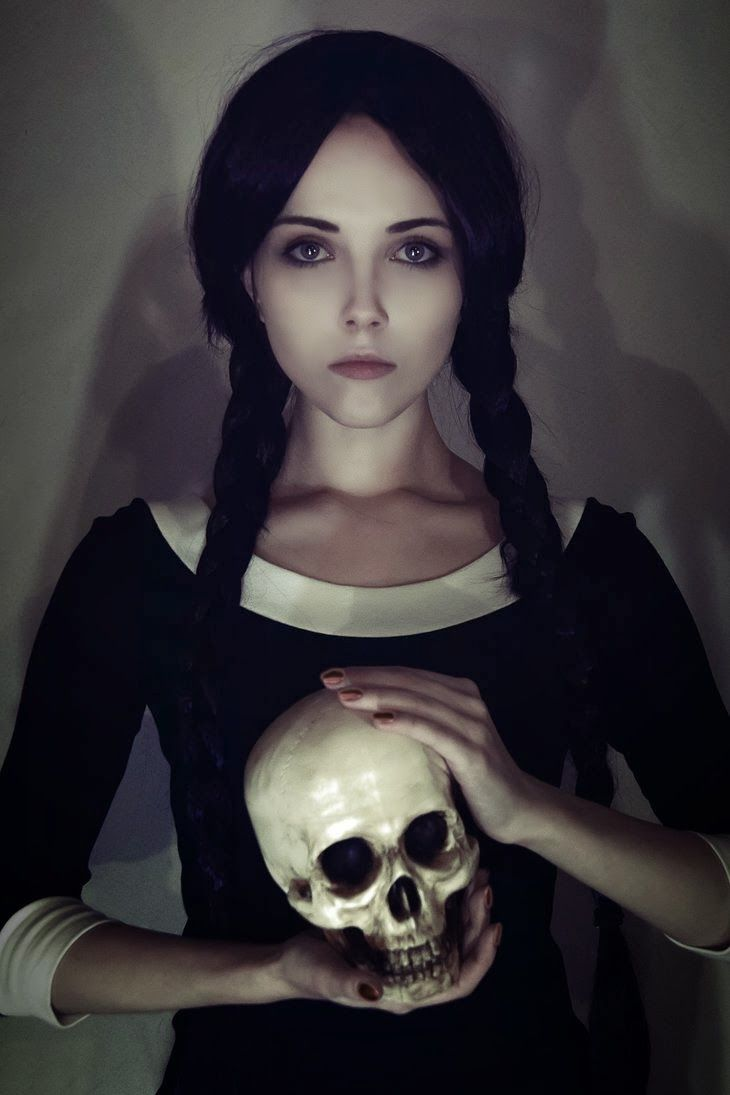 Sexy and creepy Wednesday Adams cosplay... I love everything about this down to Yorick.