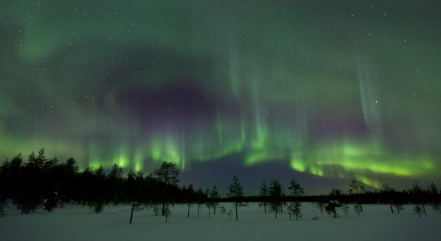 Even without daylight mysterious lights glow in Lapland in winter