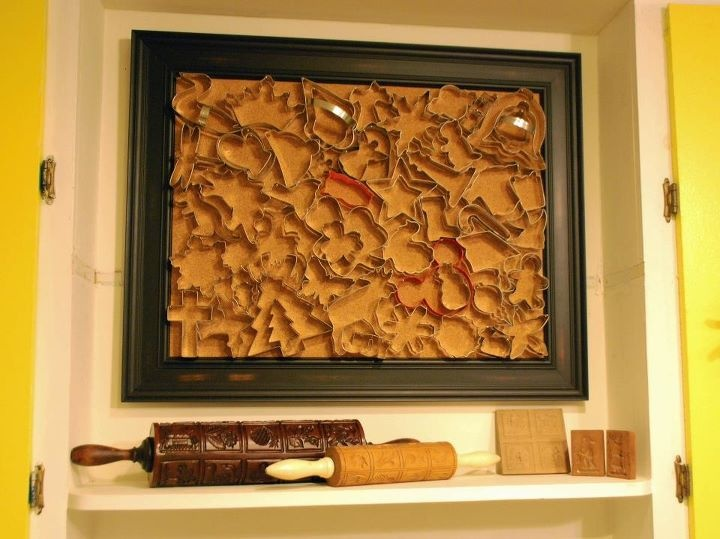 to display cookie cutters: cork board (framed,or painted,or wrapped in fabric)