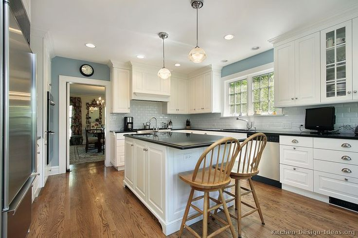 #Kitchen Idea of the Day: Early American Kitchen with wood floors, white cabinets, and soft blue walls.