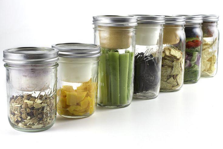 BNTO Canning Jar Lunchbox Adaptor...mini cups that fit inside Mason jar lids!  TOTAL GENIUS.  Gotta get some!