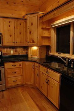kitchen with pine cabinets and black appliances - Google Search