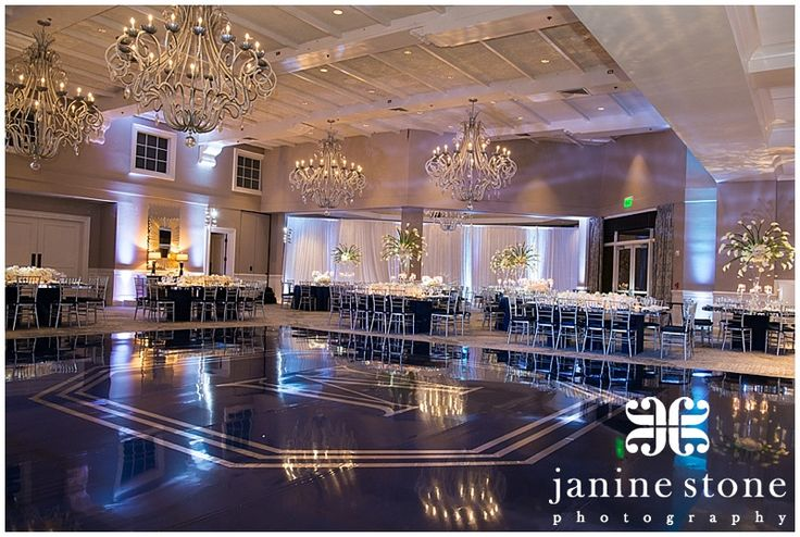 Stunning dark dance floor made the ballroom!   Janine Stone Photography. Creative Touch Parties. Top Wedding Photographers in South Florida