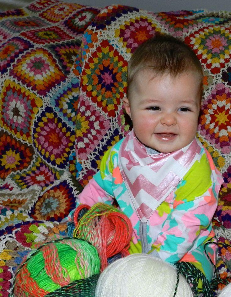 This little ball of cuteness will be an expert at crochet when she is all grown up! Littletreez bandana style bib
