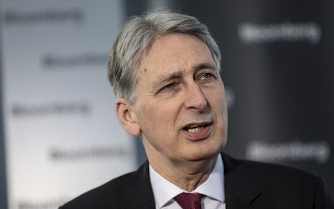 1/25/18 Theresa May rebukes Philip Hammond after he makes extraordinary public call for soft Brexit