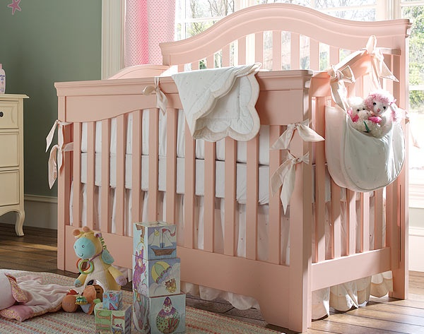 A Young America Built To Grow Bravo Crib In Peach Is A Nursery Confection:
