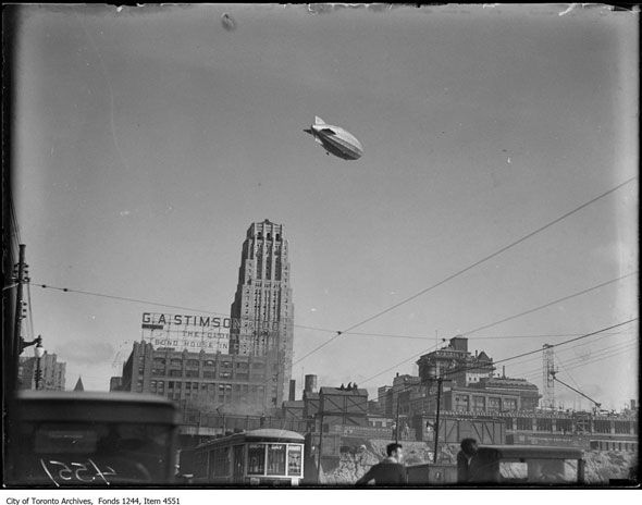 In the late summer of 1930 the people of Toronto saw something over the city not many could claim to have seen before. Humming like a giant insect, the dirigible R100 - an airship almost as long as Union Station - circled over the heads of thousands. Work stopped, traffic ground to a halt, and rooftops were packed as everyone strained to glimpse the pride of Great Britain...